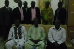 Members of the Select Committee in a group photograph with some staff of the Commission